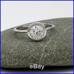 Diamond Ring Round Brilliant Vintage 18 Karat White Gold Wedding Bezel Setting